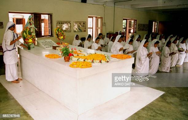 Sisters of the Missionaries of Charity recite prayers and sing hymns beside the grave of Mother Teresa 01 September at the Missionaries of Charity in...