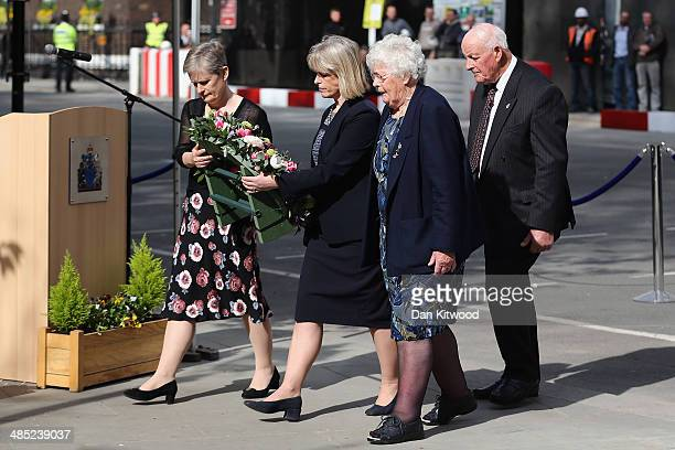 Sisters of Yvonne Fletcher Heather Aldbrook Sarah Parson and parents Tim and Queenie Fletcher lay a wreath during a memorial service for the murdered...