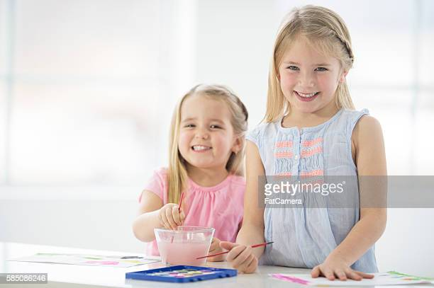 Sisters Painting Together