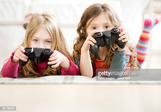 Sisters playing videogame