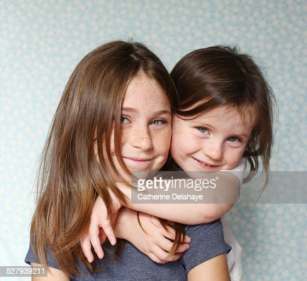 2 sisters posing together