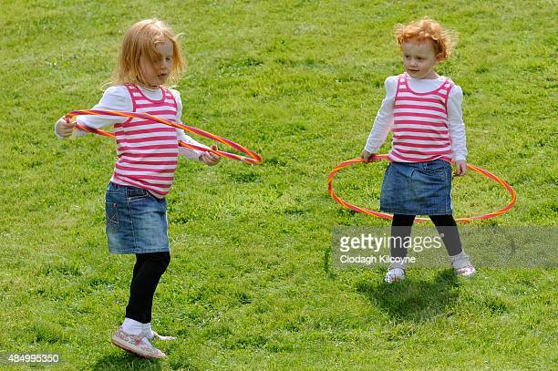 Sisters practice the hulahoop at the Irish Redhead Convention which celebrates everything to do with red hair held in the village of Crosshaven on...