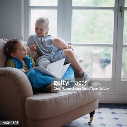 Sisters Reading Together : Photo