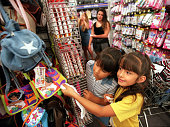 Sisters Selina and Jasmine Garibay both 7 from Carpinteria shop for purses at Walmart as family friend Jenna Keeler 13 and their mother Maria shop...