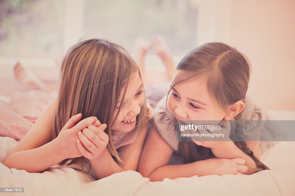 sister's sharing a laugh