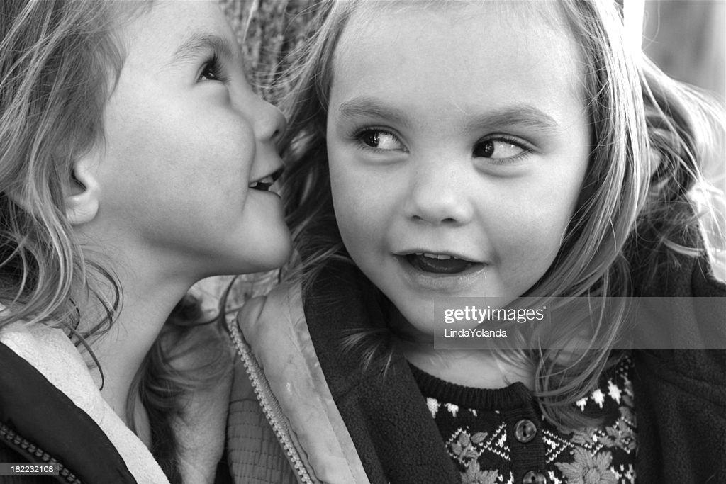 Sisters Sharing Secrets : Stock Photo
