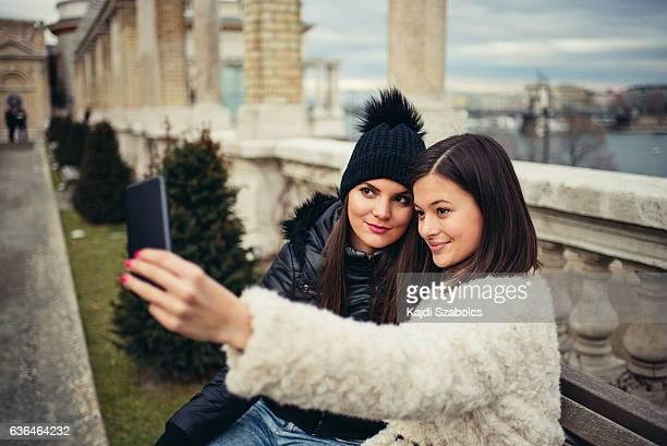 sisters taking selfie in Budapest