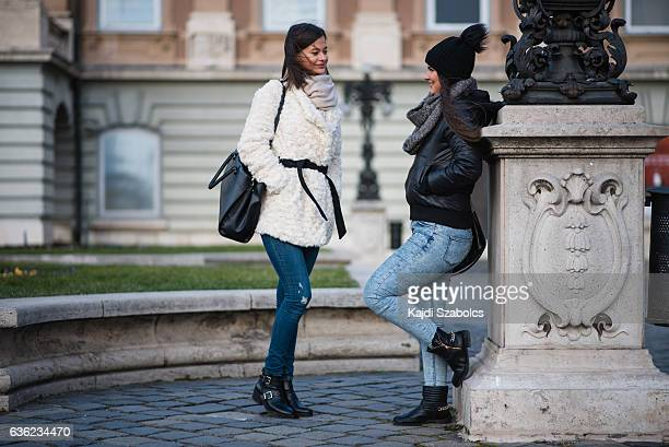 sisters talking in Budapest
