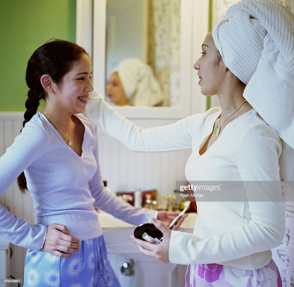 Sisters Talking in the Bathroom : Stock Photo
