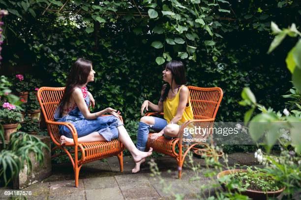Sisters talking outdoor in the backyard