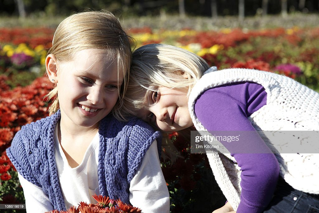 Sisters together in garden : Stock Photo