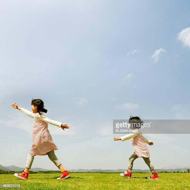 Sisters Walking At Park