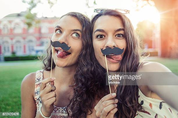 Sisters with mustaches