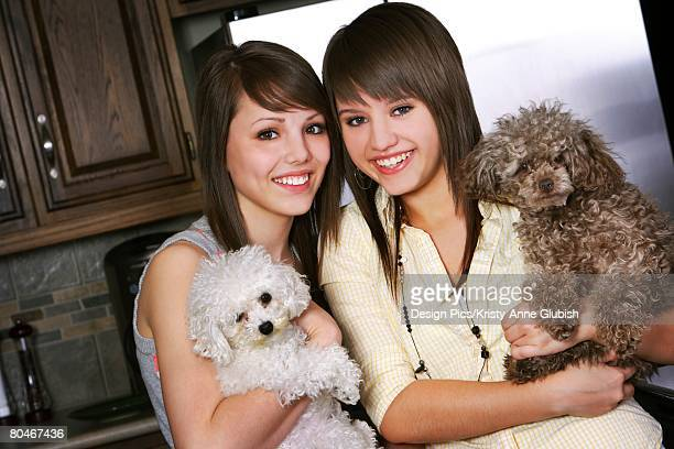 Sisters with puppies