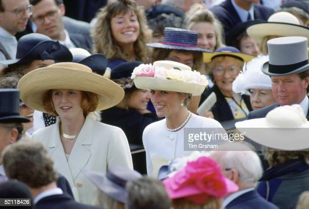 Sistersinlaw Princess Diana And The Duchess Of York At Ascot Races Behind Is Princess Diana's Bodyguard Ken Wharfe Followed By Princess Margaret
