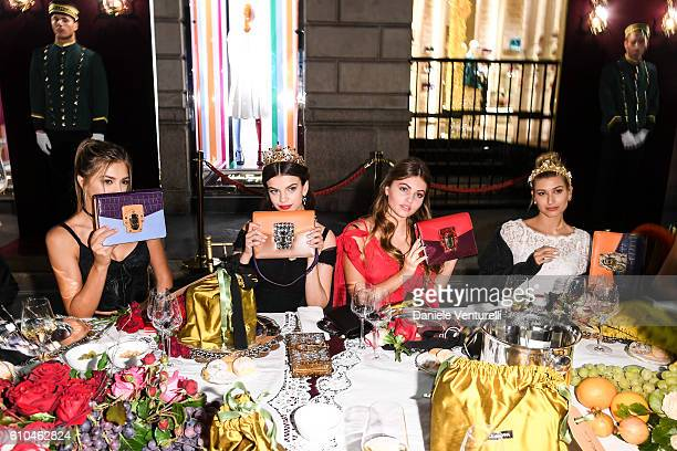 Sistine Stallone Sonia Ben Ammar Thylane Blondeau and Hailey Baldwin attend the DolceGabbana Boutique Opening Event during Milan Fashion Week...