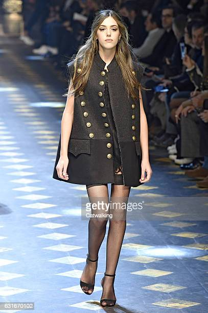 Sistine Stallone walks the runway at the Dolce Gabbana Autumn Winter 2017 fashion show during Milan Menswear Fashion Week on January 14 2017 in Milan...