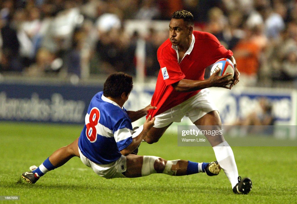 Sitaleki Makile of Tonga is tackled by Sun ChengYen of Chinese Taipei during Credit Suisse First Boston Hong Kong Sevens 2003 match between Tonga and...