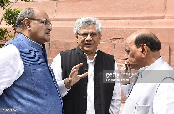 Sitaram Yechury of CPIM KC Tyagi of JDU and Devi Prasad Tripathi at Parliament during the ongoing Budget Session on March 14 2016 in New Delhi India...