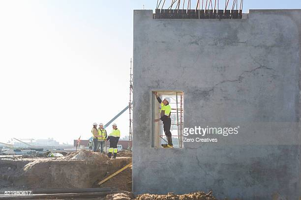 Site manager checking doorway on construction site
