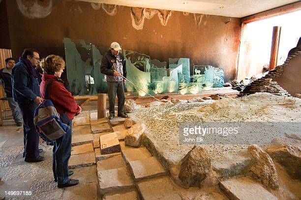 Site model with visitors in museum of pre-Columbian archaeology site.
