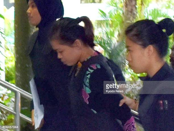 Siti Aisyah a woman from Vietnam who was charged with the murder of Kim Jong Nam the estranged halfbrother of North Korean leader Kim Jong Un enters...
