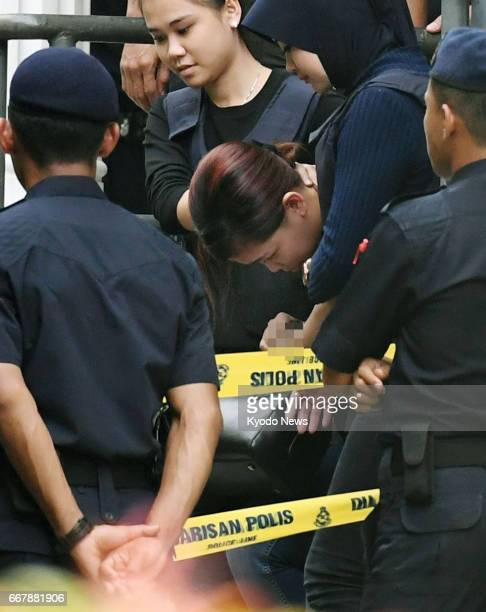 Siti Aisyah an Indonesian leaves a court near Kuala Lumpur on April 13 after judicial proceedings against her and Doan Thi Huong a Vietnamese both of...