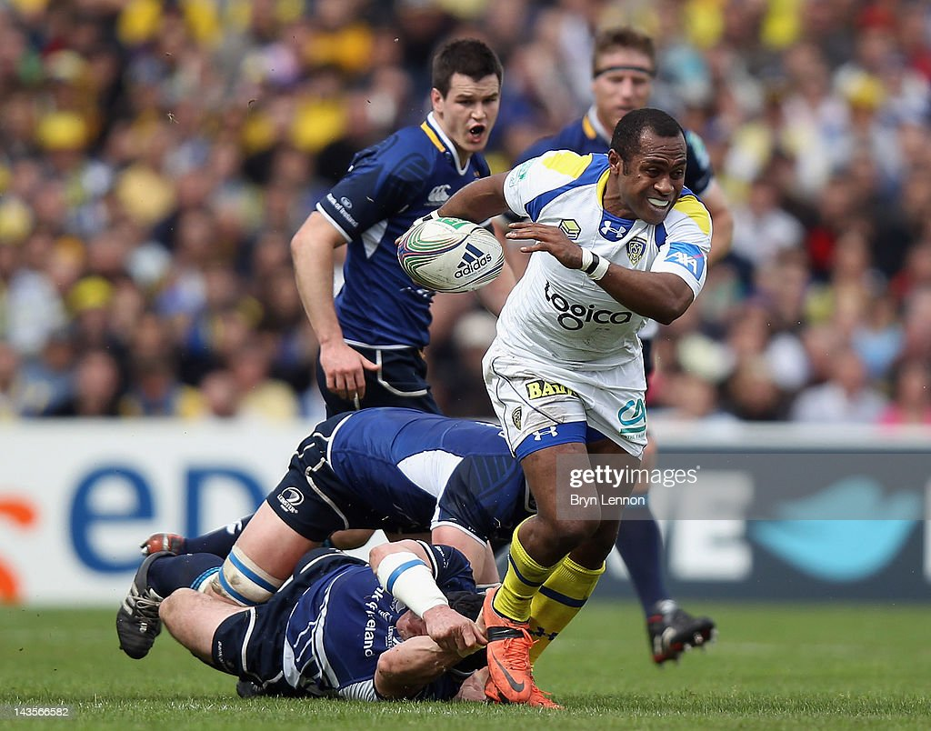 Sitiveni Sivivatu of ASM Clermont Auvergne is tackled by Jamie Heaslip of Leinster during the Heineken Cup Semi Final between ASM Clermont Auvergne and Leinster at Stade Chaban-Delmas on April 29, 2012 in Bordeaux, France.