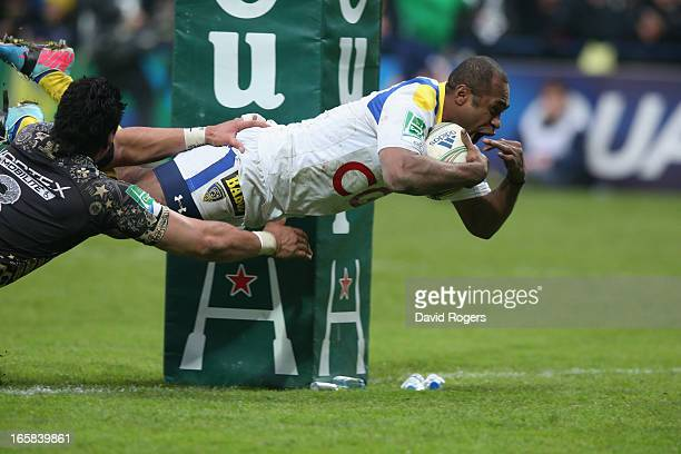 Sitiveni Sivivatu of Clermont Auvergne dives to score a try during the Heineken Cup quarter final match between Clermont Auvergne and Montpellier at...