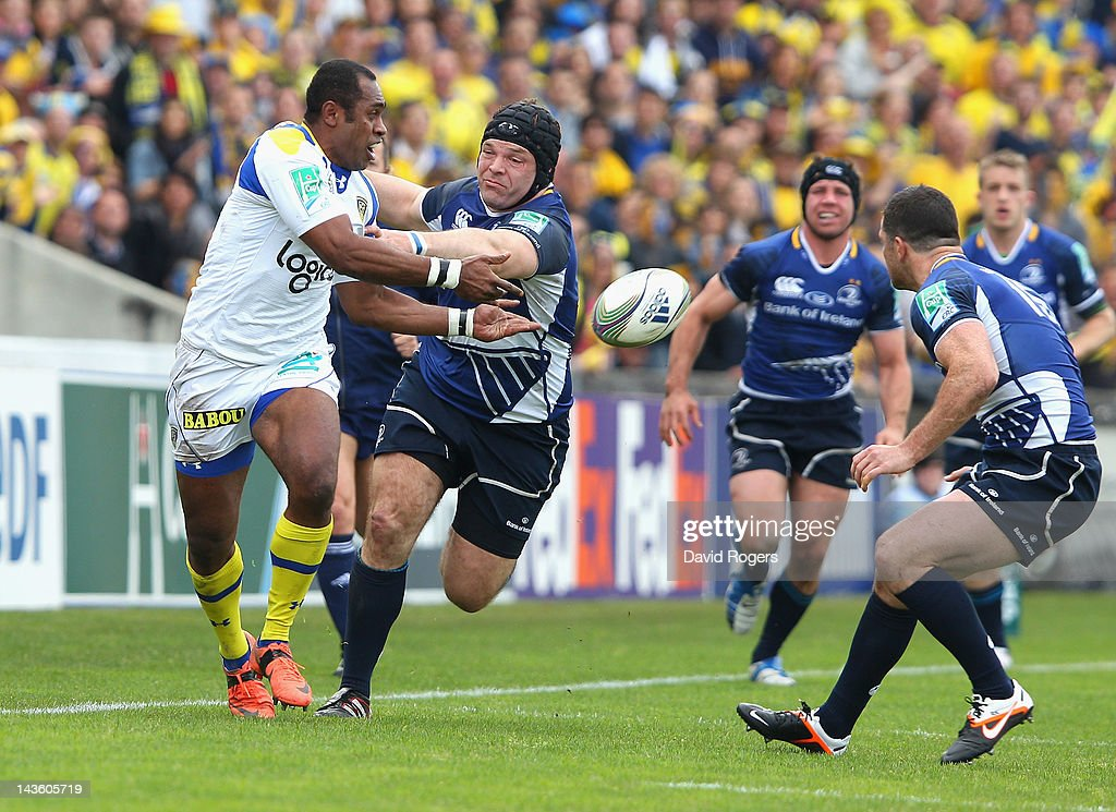 Sitiveni Sivivatu of Clermont Auvergne passes the ball as Mike Ross challenges during the Heineken Cup semi final match between ASM Clermont Auvergne and Leinster at Stade Chaban-Delmas on April 29, 2012 in Bordeaux, France.