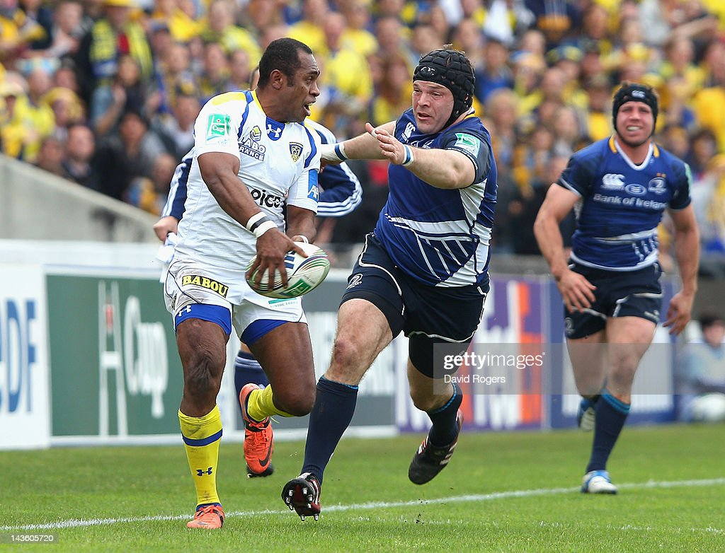 <a gi-track='captionPersonalityLinkClicked' href=/galleries/search?phrase=Sitiveni+Sivivatu&family=editorial&specificpeople=234893 ng-click='$event.stopPropagation()'>Sitiveni Sivivatu</a> of Clermont Auvergne passes the ball as Mike Ross challenges during the Heineken Cup semi final match between ASM Clermont Auvergne and Leinster at Stade Chaban-Delmas on April 29, 2012 in Bordeaux, France.