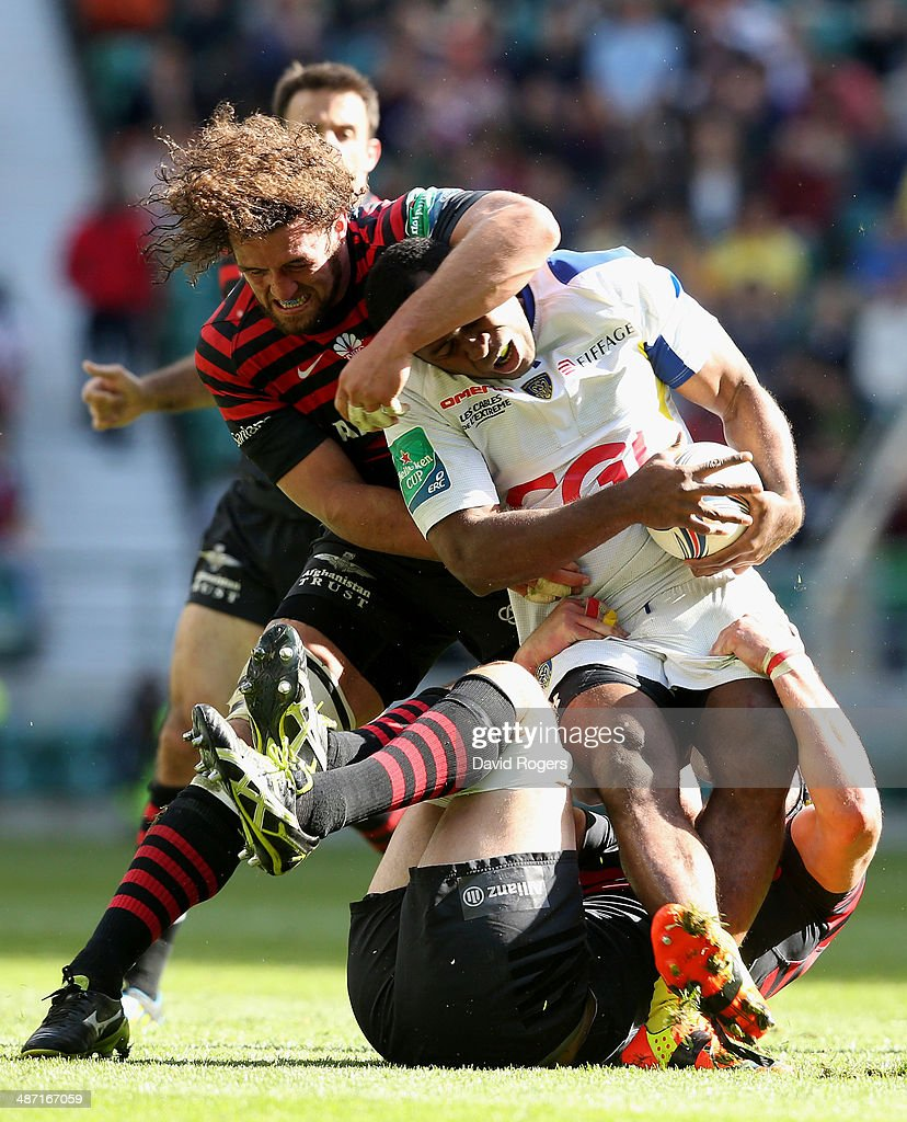 Sitiveni Sivivatu of Clermont is tackled by Jacques Burger (L) and Kelly Brown during the Heineken Cup semi final match between Saracens and Clermont Auvergne at Twickenham Stadium on April 26, 2014 in London, England.