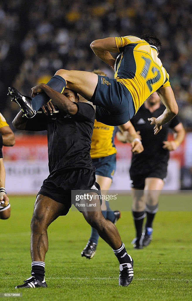 Sitiveni Sivivatu of the All Blacks makes an illegal tackle on Adam Ashley-Cooper of the Wallabies during the 2009 Bledisloe Cup match between the New Zealand All Blacks and the Australian Wallabies at the National Stadium on October 31, 2009 in Tokyo, Japan.