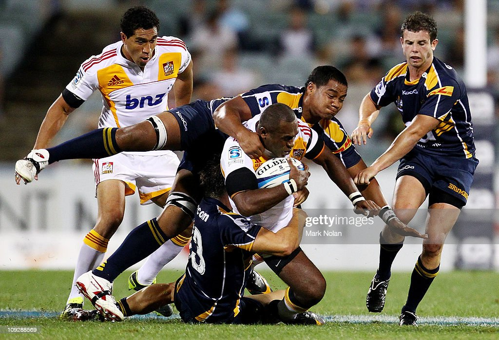 Sitiveni Sivivatu of the Chiefs is tackled by Ita Vaea of the Brumbies during the round one Super Rugby match between the Brumbies and the Chiefs at Canberra Stadium on February 19, 2011 in Canberra, Australia.
