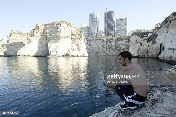 HARISSIA sits on the rocks off the shores of the Lebanese capital Beirut on December 1 2010 As Europe shivers under freezing temperatures unusually...