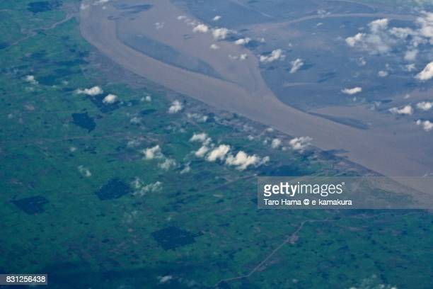 Sittang River and small village in Bago state in Myanmar daytime aerial view from airplane