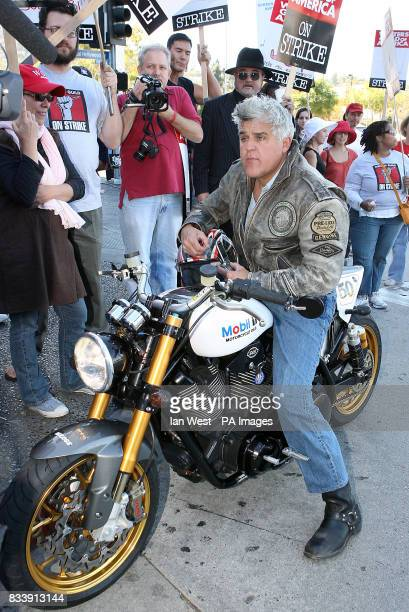Sitting astride his Mobil 1 SS Motorcycle Jay Leno shows his support for writers who are currently on strike seeking a better pay deal as they picket...