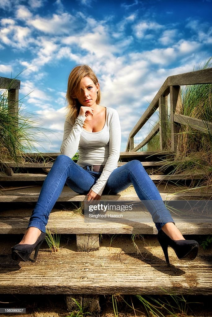 Sitting at the Beach Entrance : Stock Photo