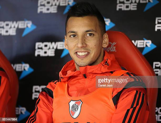 Sitting at the substitute bench Leonel Vangioni of River Plate smiles before a match between River Plate and Gimnasia y Esgrima La Plata as part of...