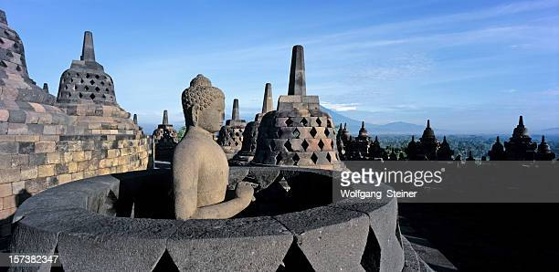 Sitting buddha inside a stupa at the borobudur temple