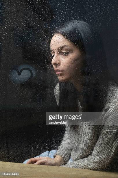 Sitting by her window on a rainy day