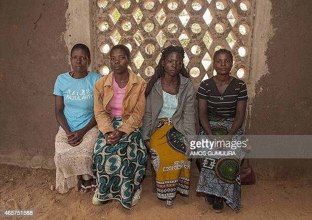Yvone Kambiza Alinafe Naison Catherine Julio Funsani and Katrina Kampingo who were underage brides sit on March 7 2015 inside a hall at the Gender...