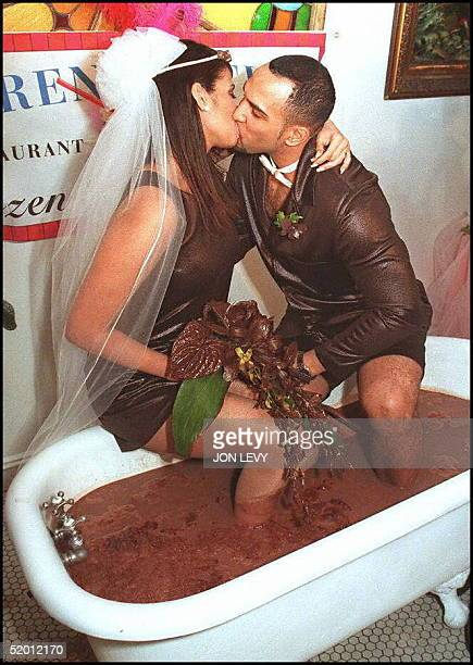 Sitting in a bathtub of frozen hot chocolate Kevin Kuhlman kisses his bride Melanie Lugo after being pronounced husband and wife at their Valentine's...