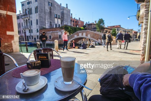 Sitting in a cafe in Venice, Italy : Stock Photo