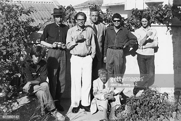 Sitting in front are Peter Orlovsky and Paul Bowles behind them stand William Burroughs Allen Ginsberg Alan Ansen Gregory Corso and Ian Sommerville...