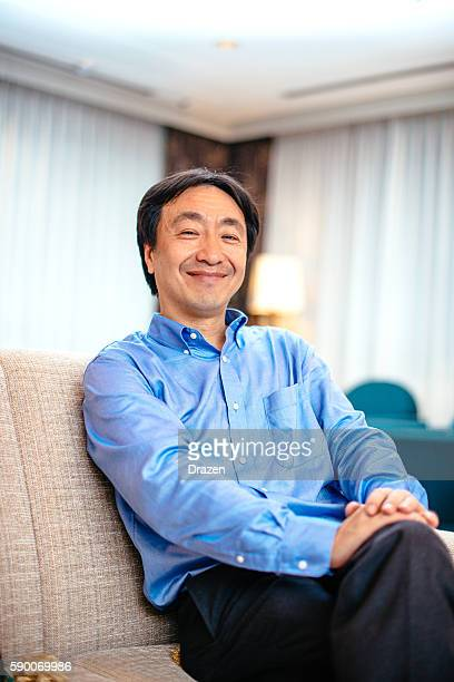 CEO sitting in his cabinet and smiling