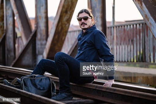 Sitting on a railroad : Stock Photo