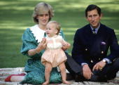 Sitting On A Rug With Her Husband Prince Charles Princess Diana Carefully Holds Prince William As He Tries Standing Up For His First Official...