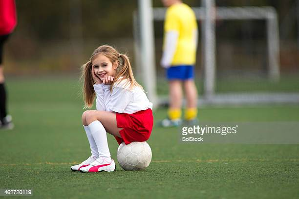 Sitting on a soccer ball