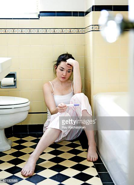 Pregnancy test stock photos and pictures getty images for Sitting on the floor during pregnancy
